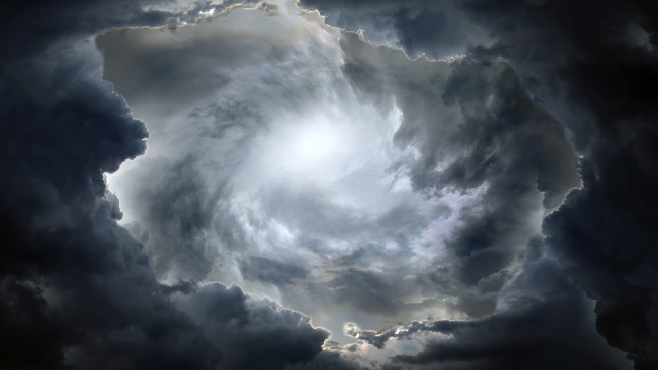 image of ominous black clouds - at the center of a hurricane.  Homeowners Insurance, Flood Insurance Metairie La - TWFG Tony Voiron